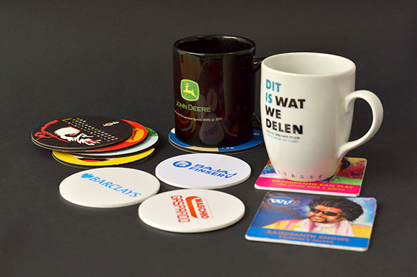 collection of printed mugs and coaster