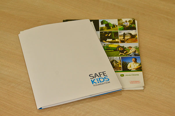 collection of printed presentation folders